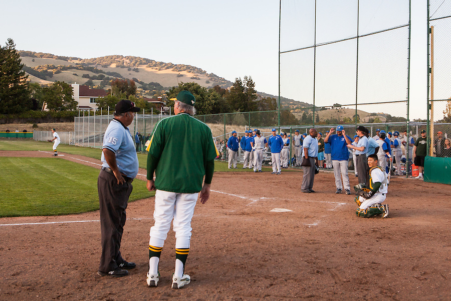 Umpires explain their decision to suspend North Coast Section Division 3 championship game between San Marin High School and Acalanes High on June 7, 2011.  The final score remained 4-4, when NCS officials later declared both teams Co-champions.