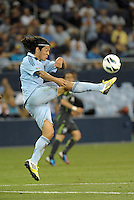 Roger Espinoza (15) Sporting KC midfielder cleras the ball..Sporting Kansas City defeated Seattle Sounders on penalty kicks, after a 1-1 tied game to win the Lamar Hunt Open Cup at LIVESTRONG Sporting Park, Kansas City, Kansas..
