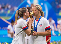 LYON,  - JULY 7: Morgan Brian #6 poses with Lindsey Horan #9 during a game between Netherlands and USWNT at Stade de Lyon on July 7, 2019 in Lyon, France.