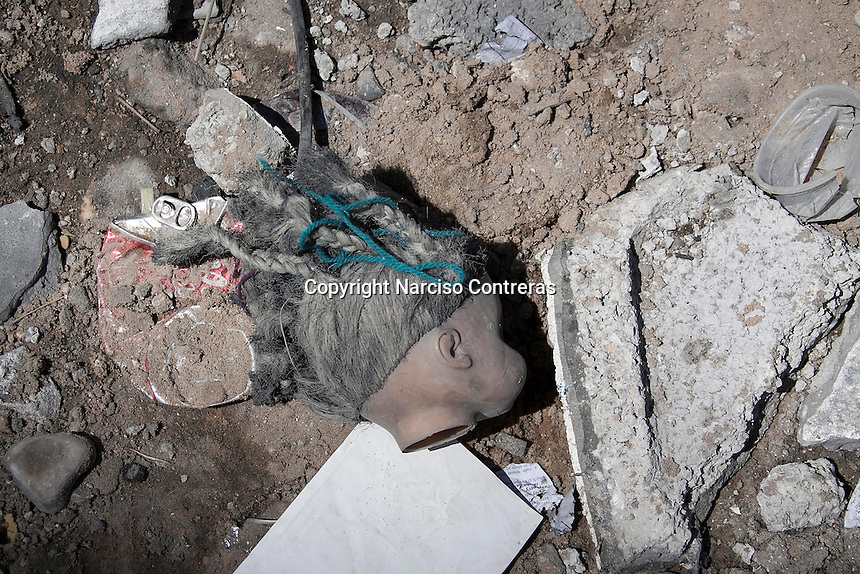 "August 26, 2014 - Gaza City, Gaza strip, Palestinian Territory: A girl's doll lays among the rubble of an apartment complex buildiing after it was targeted by an airstrike night raid in central Gaza City as ""Protective Edge"" Israeli military operation continues in the Gaza strip. (Narciso Contreras/Polaris)"