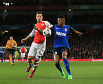 Arsenal's Mesut Ozil tussles with Monaco's Wallace who appears to handle the ball but no penalty is given<br /> <br /> Champions League - Arsenal  vs AS Monaco  - Emirates Stadium - England - 25th February 2015 - Picture David Klein/Sportimage