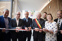 Sven Nys with Minister of Sports Philippe Muyters (N-VA) and several prominent local politicians cutting the ceremonial ribbon at the opening of the Sven Nys Cycling Center in Nys' hometown of Baal (Belgium)