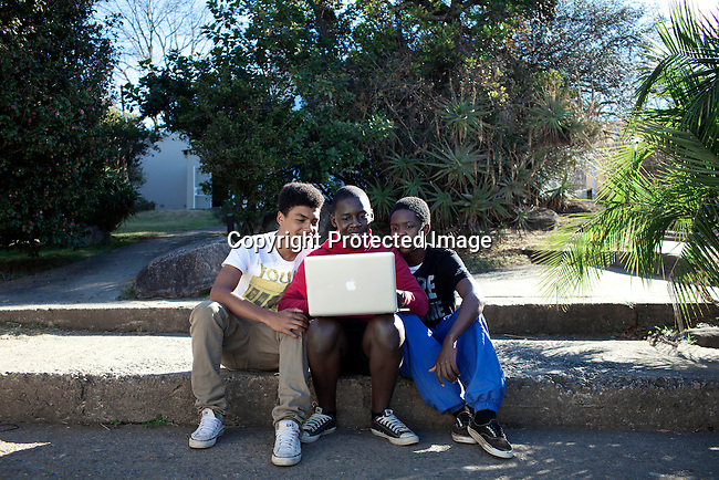 MBABANE, SWAZILAND - AUGUST 1: Students read on a laptop during a break at Waterford Kamhlaba United World College of Southern Africa, a secondary school on August 1, 2013 in Mbabane, Swaziland. The school was funded in 1963 with 16 students during South Africa's Apartheid years. It's a multiracial school with 600 students with about 50 countries around the world. The majority are African students. (Photo by: Per-Anders Pettersson)