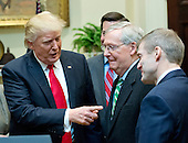 """United States President Donald J. Trump, left, speaks with US Senate Majority Leader Mitch McConnell (Republican of Kentucky), center and US Representative Jim Jordan (Republican of Ohio), right prior to signing H.J. Res. 38, disapproving the rule submitted by the US Department of the Interior known as the Stream Protection Rule in the Roosevelt Room of the White House in Washington, DC on Thursday, February 16, 2017.  The Department of Interior's Stream Protection Rule, which was signed during the final month of the Obama administration, """"addresses the impacts of surface coal mining operations on surface water, groundwater, and the productivity of mining operation sites,"""" according to the Congress.gov summary of the resolution.<br /> Credit: Ron Sachs / Pool via CNP"""