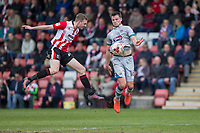 James Berrett of Grimsby controls the ball under pressure from Carl Winchester of Cheltenham Town during the Sky Bet League 2 match between Cheltenham Town and Grimsby Town at the The LCI Rail Stadium,  Cheltenham, England on 17 April 2017. Photo by PRiME Media Images / Mark Hawkins.