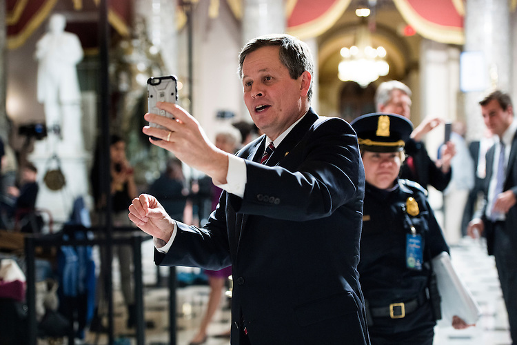 UNITED STATES - FEBRUARY 28: Sen. Steve Daines, R-Mont., Snapchats in Statuary Hall before President Donald Trump's address to a joint session of Congress on Tuesday, Feb. 28, 2017. (Photo By Bill Clark/CQ Roll Call)