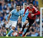 David Silva of Manchester City tussles with Chris Smalling of Manchester United during the Barclays Premier League match at The Etihad Stadium. Photo credit should read: Simon Bellis/Sportimage