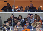United States President Barack Obama watches the Syracuse vs. Marquette East Regional Final basketball game with unidentified friends from a box at the Verizon Center in Washington, Saturday, March 30, 2013..Credit: Martin Simon / Pool via CNP
