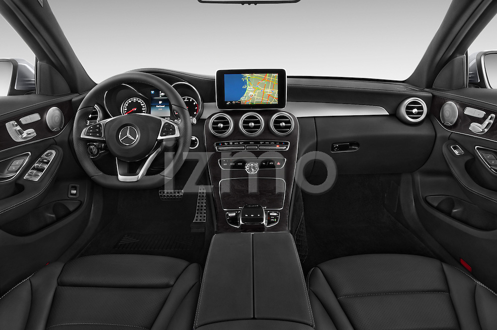 Stock photo of straight dashboard view of a 2015 Mercedes Benz C-Class C300 Sport 4 Door Sedan Dashboard