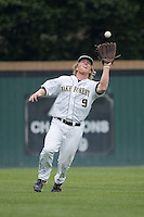 Left fielder Willy Fox (9) of the Wake Forest Demon Deacons catches a fly ball versus the Florida State Seminoles at Gene Hooks Stadium on the campus of Wake Forest University in Winston-Salem, NC, Friday, March 28, 2008.