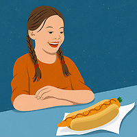 Girl delighted at carrot in hot dog bun ExclusiveImage
