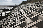 Energy dissipating blocks in sloping sea wall.  Coastal defences, Cobbolds Point, Felixstowe, Suffolk, England. The complex surface and slope angle breaks the force of waves and allows water to flow downslope without scouring.