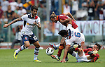 Calcio, Serie A: Roma vs Bologna. Roma, stadio Olimpico, 16 settembre 2012..AS Roma defender Federico Balzaretti, second from left, and midfielder Alessandro Florenzi, right, are challenged by Bologna midfielder Panagiotis Kone, of Greece, left, and midfielder Safir Taider, of France, during the Italian Serie A football match between AS Roma and Bologna at Rome's Olympic stadium, 16 september 2012..UPDATE IMAGES PRESS/Isabella Bonotto