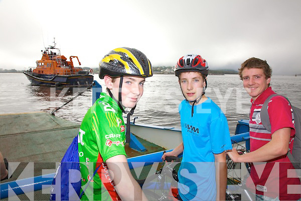 Over one hundred cyclists took part in the annual cycle from Kells to Valentia on Sunday in aid of The RNLI & Cahersiveen Hospice, pictured here on the Valentia Island Ferry were l-r; Pierce Lynch, Brandon Moran & Eamon Moore.