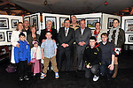 26-2-2012: Former Taoiseach Brian Cowen pictured with Tralee photographer John Cleary of Kerry Landscapes and his extended family in Paidi O'Se pub in Ventry, County Kerry on Sunday after the annual Paidi O'Se GAA tournament finished in on Sunday. Mr Cowen opened a photographic exhibition for Tralee photographer John Cleary..Picture by Don MacMonagle