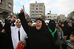 .Palestinian women chant slogans during the funeral of Hamas leader Nizar Rayan, and four of his wives and ten of his children, who were killed Thursday in an Israeli airstrike, in the town of Beit Lahiya, northern Gaza Strip, Friday, Jan. 2, 2009. Israel bombed a mosque it says had been used to store weapons and destroyed the homes of more than a dozen Hamas operatives on Friday, the seventh day of a blistering offensive in Gaza and the day after an airstrike killed a prominent Hamas figure APAIMAGES PHOTO / Ashraf Amra