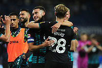 Matt Grimes of Swansea City celebrates with George Byers of Swansea City at full time during the Sky Bet Championship match between Queens Park Rangers and Swansea City at The Kiyan Prince Foundation Stadium in London, England, UK. Wednesday 21, August 2019