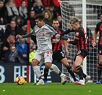 Liverpool's Roberto Firmino (left) is tackled by Bournemouth's David Brooks (right) <br /> <br /> Photographer David Horton/CameraSport<br /> <br /> The Premier League - Bournemouth v Liverpool - Saturday 8th December 2018 - Vitality Stadium - Bournemouth<br /> <br /> World Copyright © 2018 CameraSport. All rights reserved. 43 Linden Ave. Countesthorpe. Leicester. England. LE8 5PG - Tel: +44 (0) 116 277 4147 - admin@camerasport.com - www.camerasport.com