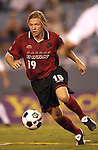 DALLAS, TX -OCTOBER 2: Bobby Rhine #19 of the Dallas Burn in action against Colorado Rapids at Cotton Bowl in Dallas on October 2, 2002 in Dallas, Texas. (Photo by Rick Yeatts) Rhine's career consisted of 212 games making 136 starts, played more than 12,000 minutes scoring 23 goals and 34 recorded assists.