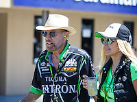 Jul 30, 2016; Sonoma, CA, USA; NHRA sponsor John Paul DeJoria (left) and wife Eloise Broady in attendance during qualifying for the Sonoma Nationals at Sonoma Raceway. Mandatory Credit: Mark J. Rebilas-USA TODAY Sports