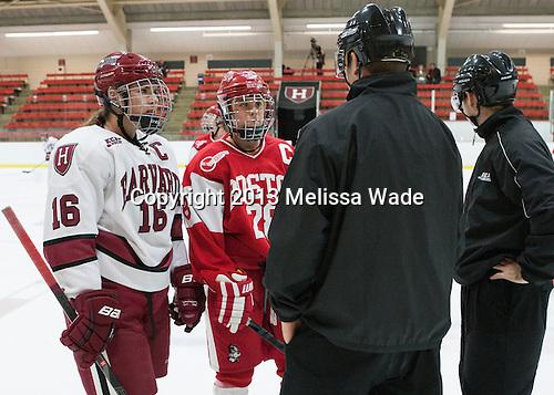 Marissa Gedman (Harvard - 16), Louise Warren (BU - 28), CJ Hanafin, Marty Hughes - The Harvard University Crimson defeated the visiting Boston University Terriers 3-1 on Friday, November 22, 2013, at Bright-Landry Hockey Center in Cambridge, Massachusetts.