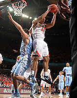 Virginia guard Malcolm Brogdon (15) grabs a the rebound next to North Carolina forward Jackson Simmons (21) during an NCAA basketball game against Virginia Monday Jan. 20, 2014 in Charlottesville, VA. Virginia defeated North Carolina 76-61.