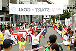 September 30, 2017, Tokyo, Japan - People cross finish line of a family run at a charity run for the Special Olympics at Toyota's showroom Mega Web in Tokyo on Saturday, September 30, 2017. Some 1,800 people participated the charity event as Japan's Special Olympic Games will be held in Aichi in 2018.   (Photo by Yoshio Tsunoda/AFLO) LWX -ytd-