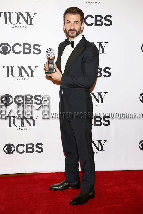 NEW YORK, NY - JUNE 11:  Michael Aonov poses with an award at the 71st Annual Tony Awards, in the press room at Radio City Music Hall on June 11, 2017 in New York City.  (Photo by Walter McBride/WireImage)