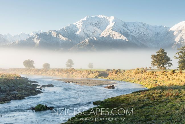 Waitangitaona River near Whataroa with fresh snow on mountains in background, West Coast, South Westland, New Zealand
