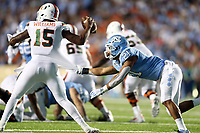 CHAPEL HILL, NC - SEPTEMBER 07: Chazz Surratt #21 of the University of North Carolina grabs ahold of Jarren Williams #15 of the University of Miami during a game between University of Miami and University of North Carolina at Kenan Memorial Stadium on September 07, 2019 in Chapel Hill, North Carolina.
