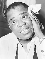 portrait of jazz musician Louis Armstrong in 1953<br /> <br /> PHOTO : Herman Hiller