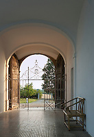 The imposing main entrance to La Chiesoula with its massive double doors and wrought-iron gates