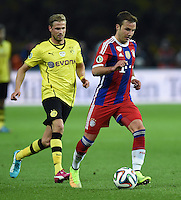 FUSSBALL  DFB POKAL FINALE  SAISON 2013/2014 Borussia Dortmund - FC Bayern Muenchen     17.05.2014 Mario Goetze (FC Bayern Muenchen) gegen Oliver Kirch (Borussia Dortmund)
