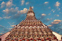 Central prang or tower of Wat Arun, is the mythical Mount Meru, Bangkok, Thailand. Wat Arun is also known as the Temple of the Dawn.