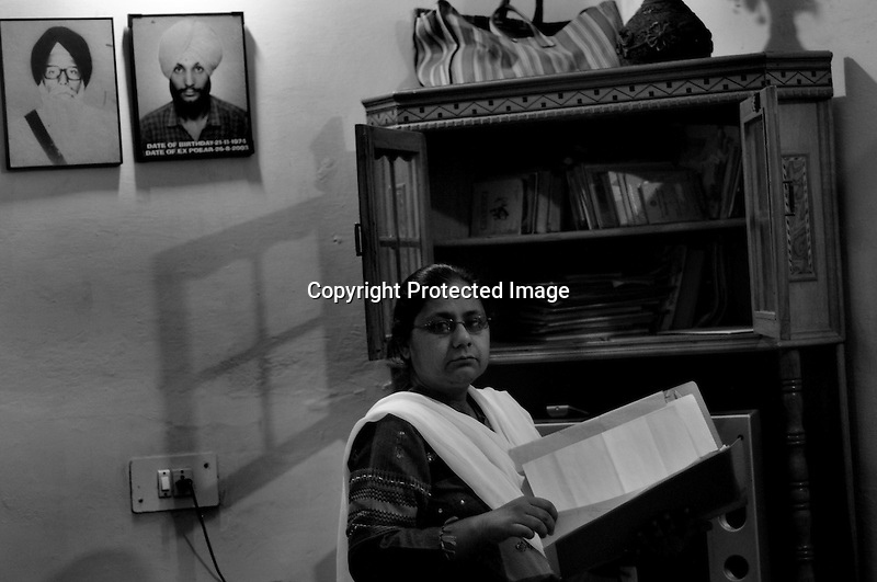 Nirpreet Kaur is an activist against the Sikh Genocide in 1984. Her family was a millionaire running a big and successful transportation business. All their trucks and buses were burnt and her father was burnt alive in front of her eyes. She is also an important witness in the Sikh Genocide case in Delhi High Court. She has now moved into Tilak Vihar from Palam colony where she used to live in 1984. Tilak Vihar in New Delhi is called the widow colony. Widows and children of the Sikhs who were killed in 1984 Sikh Genocide live here. Four thousand Sikhs were killed in 72 hours in Delhi alone but no body till date has been punished for such an inhuman crime. Illiteracy, drug addiction, child labour and immense poverty characterize the area. Twenty five years ago all the male family members above the age of 15 were killed and burnt, leaving their uneducated widows and children behind to suffer, even after 25 years. The present generation is jobless, steeped in alcoholism and have lost their directions in life. November 2009. New Delhi, India, Arindam Mukherjee