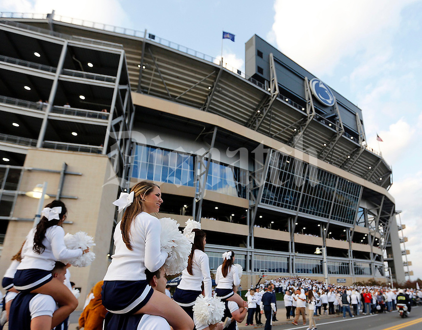 The Penn State cheerleaders lead the band past the stadium before Saturday's NCAA Division I football game at Beaver Stadium in University Park, PA on October 25, 2014. (Columbus Dispatch photo by Jonathan Quilter)