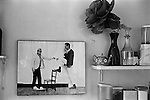 Patrick Procktor artist London 1969. Photograph on wall of kitchen David Hockney + PP. His kitchen in his Manchester Street flat London.
