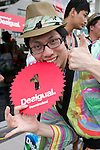 "Tokyo, Japan - The first customer poses for cameras, he came one day ago to Tokyo's Harajuku fashion district to wait for the grand opening of the Desigual store. A fashion chain called ""Seminaked Party by Desigual"" offers the first 100 customers (wearing swimsuit) free clothing items at the grand opening in Tokyo, Japan, June 22, 2013. More than 4,000 people attend the Seminaked Party around the world. (Photo by Rodrigo Reyes Marin/AFLO)"