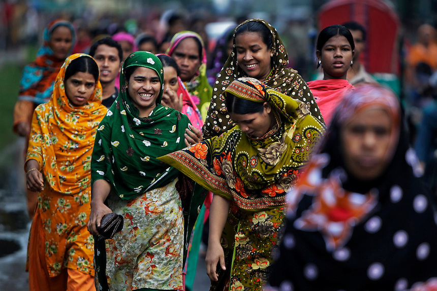 Bangladeshi garment workers arrive for work early morning in Dhaka, Bangladesh, Wednesday, Sept. 12, 2012.