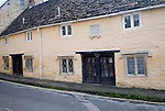 Row of historic almshouses in Kingsbury Street, Calne north Wiltshire, England erected by Dr John Tounson, vicar of Bremhill, in 1682