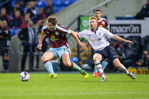 26.07.2016. Macron Stadium, Bolton, England. Pre Season Football Friendly. Bolton Wanderers versus Burnley. Burnley FC defender James Tarkowski turns away from trouble with with the ball.