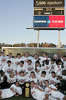 Maryland poses with the NCAA Championship trophy as the scoreboard tells the story. The University of Maryland defeated the University of New Mexico 1-0 in the NCAA Final at SAS Stadium in Cary, North Carolina, Sunday, December 11, 2005.