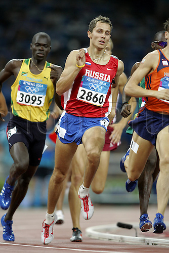 26 August 2004: Russian runner Yuriy Borzakovskiy (2860) (RUS) competing in the 2nd Men's 800m Semi-Final held at the Olympic Stadium. Borzakovskiy went on to win the gold medal in the final. 2004 Olympic Games, Athens, Greece. Photo: Neil Tingle/Action Plus...040826 olympics olympic athletics track and field athlete man men men's run runner runners running distance
