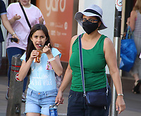 People wear a variety of facemasks around in Cambridge, UK on July 30th 2020<br /> <br /> Photo by Keith Mayhew