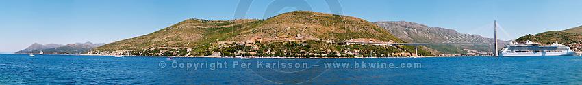 The new Dubrovnik Franjo Tudman Franja Tudmana suspension bridge at the entrance to Gruz docks harbour, Rijeka Dubrovacka bay and Kanal Daksa canal. A big luxurious cruising ship. Luka Gruz harbour. Babin Kuk peninsula. Dubrovnik, new city. Dalmatian Coast, Croatia, Europe.