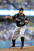 Colorado Rockies pitcher Jhoulys Chacin #45 pitches against the Los Angeles Dodgers at Dodger Stadium on July 26, 2011 in Los Angeles,California. Los Angeles defeated Colorado 3-2.(Larry Goren/Four Seam Images)