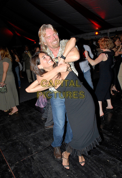 CATERINA MURINO & RICHARD BRANSON.In Jamaica..July 4th, 2006.Ref: FIN.full length black dress dancing full headlock hug embrace.www.capitalpictures.com.sales@capitalpictures.com.© Capital Pictures.