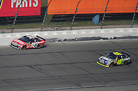 Sept. 28, 2008; Kansas City, KS, USA; Nascar Sprint Cup Series driver Carl Edwards (99) slides along the wall on the last lap in front of Jimmie Johnson (48) during the Camping World RV 400 at Kansas Speedway. Mandatory Credit: Mark J. Rebilas-