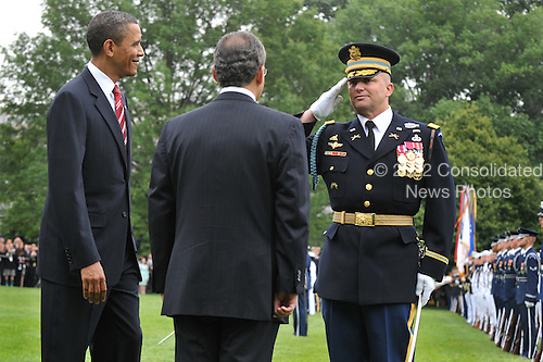 United States President Barack Obama (L) and Mexican President Felipe Calderon review the troops during Calderon's welcoming ceremony on the South Lawn of the White House in Washington on Wednesday, May 19, 2010. .Credit: Kevin Dietsch - Pool via CNP