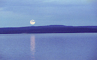 24 JUN 2002 - KHOVSGOL NATIONAL PARK, MONGOLIA - The moon rises above Khovsgol Nuur. (PHOTO (C) NIGEL FARROW)